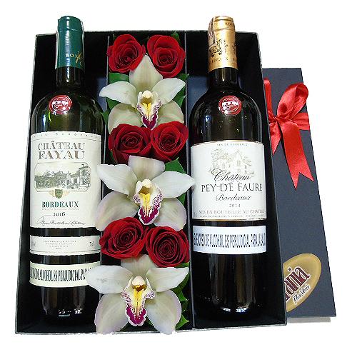 rosas y orquideas en caja con 2 vinos frances irania floristeria bogota