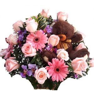 arreglo para nacimiento con peluche irania floristeria bogota